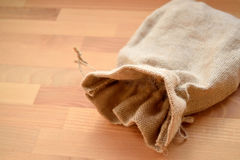 Sack on the wood table Royalty Free Stock Photos