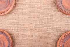 Sackcloth Background Decorated With Terraccota Stock Photo