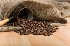 Sackcloth bag with cezve and roasted coffee beans Royalty Free Stock Photography