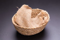 Sackcloth in basket weave on black background.  Stock Images