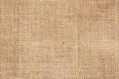 Sackcloth or burlap background with visible texture  copy space for text and other web  print design elements. Royalty Free Stock Photo