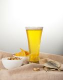 Sackcloth, glass of beer, pistachio, salty fish Royalty Free Stock Photography