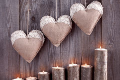 Sackcloth handmade hearts with lace  candles illuminated from be Stock Images