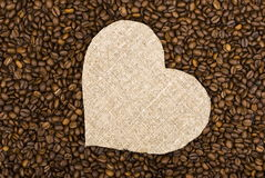 Sackcloth heart on coffee beans Royalty Free Stock Photography