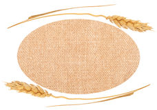 Sackcloth material and ears of wheat Stock Photo