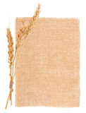 Sackcloth material and ears of wheat Royalty Free Stock Photo