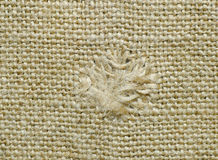 Sackcloth with a patched hole. Royalty Free Stock Images