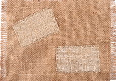 Sackcloth Tags On Sackcloth Material Royalty Free Stock Image