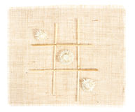 Sackcloth with Tic Tac Toe game. Pattern with straws on burlap Royalty Free Stock Images