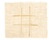 Sackcloth with Tic Tac Toe game pattern. With straws on burlap Royalty Free Stock Photography