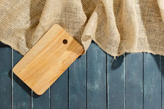 Sackcloth and wooden board stock photo
