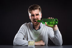 Sacked Manager With Bottle Royalty Free Stock Photography