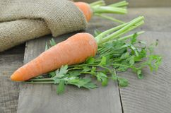 Sacking with Fresh carrots on wooden table. Sacking with carrots on wooden table Stock Photo