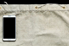 Sackleinen mit schwarzem Beschneidungspfad am Handy für das Einbrennen Stockfotos
