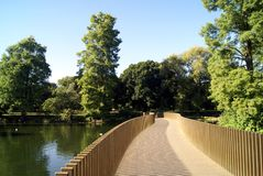 Sackler Crossing bridge over a lake at The Royal Botanic Gardens, Kew, London, England, Europe Stock Photos