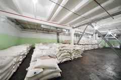 Sacks of corn grits for beer in Ochakovo factory Stock Photography