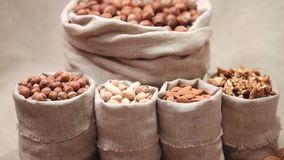 Sacks of different types nuts stock video footage
