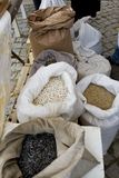 Sacks full with chickpeas, beans, buckwheat, millet, wheat, spelled, lentils, Einkorn wheat grains. Variety of beans, grains and s. Eeds on a farmers market royalty free stock photos