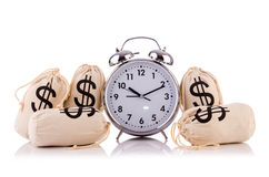 Sacks of money and alarm clock