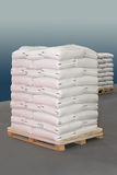 Sacks pallet. White polypropylene sacks at transport pallet Royalty Free Stock Photo