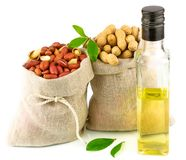 Sacks with peanut and glass bottle of oil with leaves Stock Images