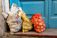 Sacks of potatoes and onions Royalty Free Stock Image
