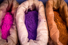 Sacks of purple, pink and orange paint, Chefchaouen, Morocco. Sacks of purple, pink and orange paint in the city of Chefchaouen, Morocco Stock Images