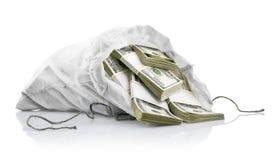 Saco blanco con el dinero de los dólares Fotos de archivo libres de regalías