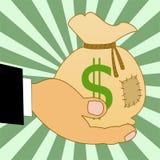 Saco con los dólares de una muestra en una mano, ejemplo Imagenes de archivo