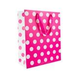 Saco cor-de-rosa do presente do às bolinhas Imagens de Stock