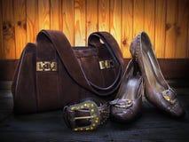 Saco da camurça, sapatas de couro e correia Imagens de Stock
