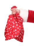 Saco da terra arrendada da mão de Papai Noel dos presentes Foto de Stock Royalty Free