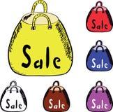 Saco de compra amarelo, vermelho, azul e transparente Fotos de Stock Royalty Free