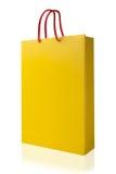 Saco de compras amarelo, isolado com o trajeto de grampeamento no backgr branco Imagens de Stock Royalty Free