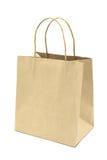 Saco de compras do papel de Brown isolado no fundo branco Imagem de Stock