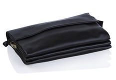Saco de couro preto em um fundo branco Imagens de Stock