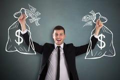 Saco de Holding Drawn Money do homem de negócios foto de stock royalty free