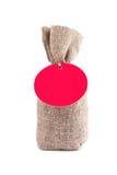 Saco de la lona con la etiqueta en blanco Imágenes de archivo libres de regalías