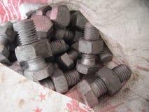 Saco de las industrias de acero del tornillo de la tuerca imagen de archivo