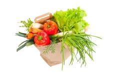 Saco de mantimento completamente de legumes frescos Fotografia de Stock
