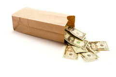 Saco de papel de Brown com Estados Unidos vinte notas de dólar que saem d Fotos de Stock