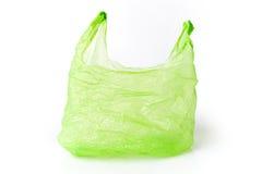 Saco de plástico verde isolado Fotos de Stock Royalty Free