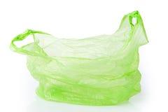 Saco de plástico verde isolado Fotos de Stock