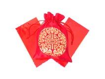 Saco de seda vermelho do dinheiro com envelopes vermelhos Foto de Stock Royalty Free