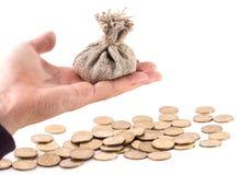 Saco do dinheiro com as moedas isoladas no fundo branco Imagem de Stock Royalty Free