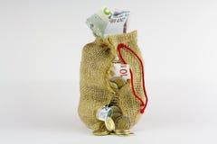 Saco do dinheiro em um fundo branco Foto de Stock