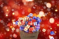 saco do Natal 3D de presentes no fundo dos flocos de neve e do bokeh Foto de Stock