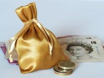 Saco dourado Imagens de Stock