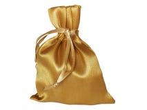 Saco dourado em um fundo branco Foto de Stock