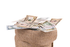 Saco lleno con los billetes de dólar Foto de archivo libre de regalías